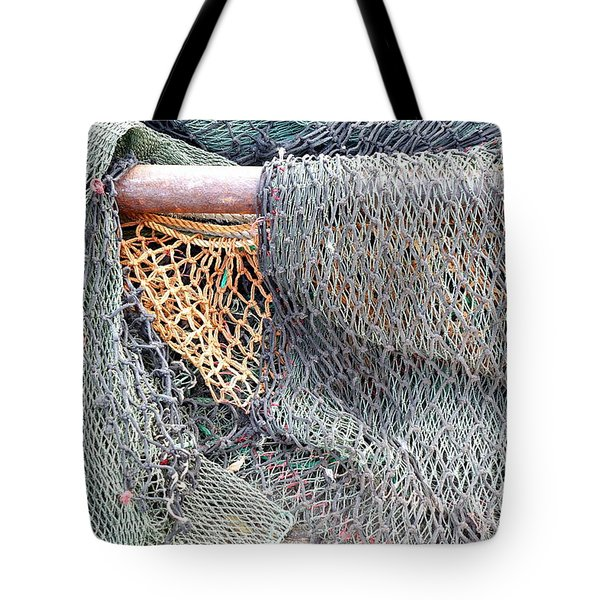 Tote Bag featuring the photograph Old Discarded Fishing Nets by Yali Shi