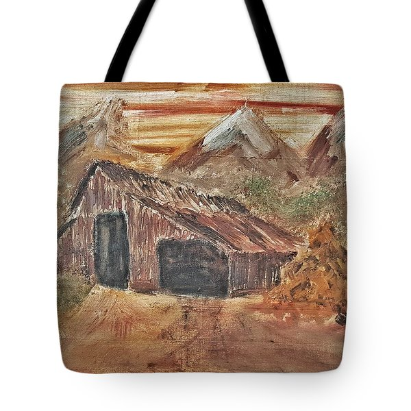 Old Farmhouse With Hay Stack In A Snow Capped Mountain Range With Tractor Tracks Gouged In The Soft  Tote Bag