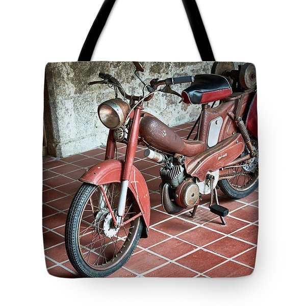 Tote Bag featuring the photograph Old Motorcycle In The Monastery Of Santo Estevo De Ribas Del Sil by Eduardo Jose Accorinti
