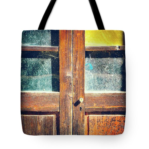 Tote Bag featuring the photograph Old Rotten Door by Silvia Ganora