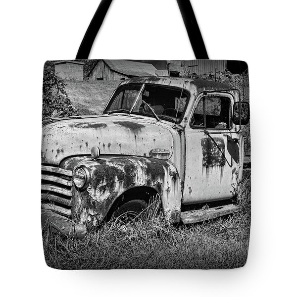 Tote Bag featuring the photograph Old Rusty Chevy In Black And White by Paul Ward