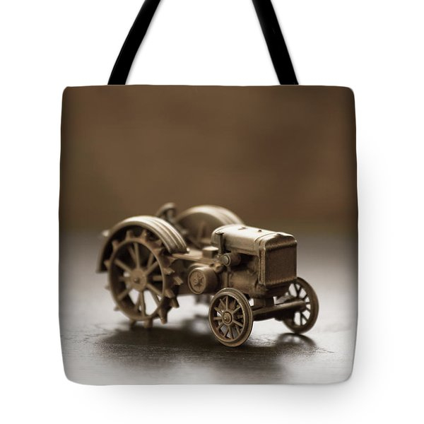 Tote Bag featuring the photograph Old Toy Tractor by Edward Fielding