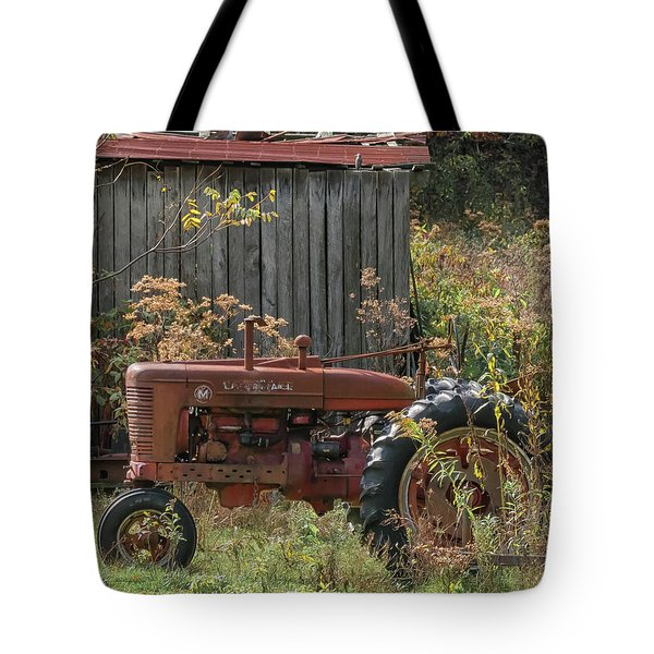 Old Tractor On The Farm. Tote Bag