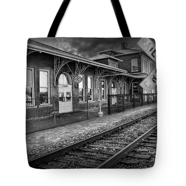 Old Train Station With Crossing Sign In Black And White Tote Bag
