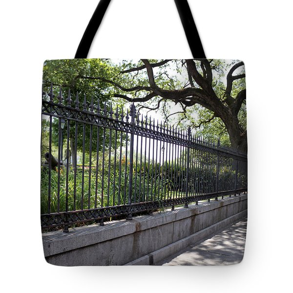 Tote Bag featuring the photograph Old Tree And Ornate Fence by Todd Blanchard