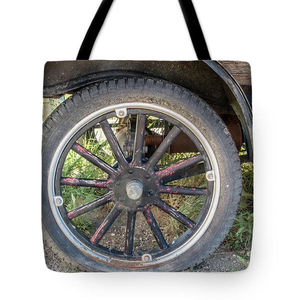 Old Truck Tire In Rural Rocky Mountain Town Tote Bag by Peter Ciro