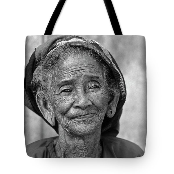Tote Bag featuring the photograph Old Vietnamese Woman by Silva Wischeropp