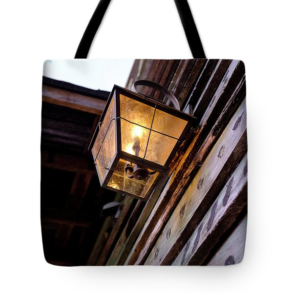 Old Vintage Light On A Wooden Wall In Saint Augustine Florida Tote Bag