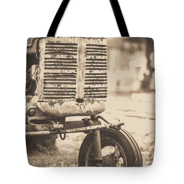 Tote Bag featuring the photograph Old Vintage Tractor Brown Toned by Edward Fielding