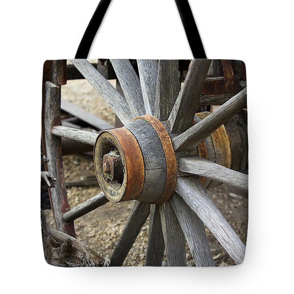 Tote Bag featuring the photograph Old Waagon Wheel by Phyllis Denton