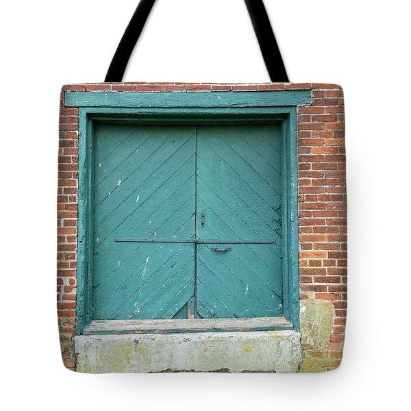 Old Warehouse Loading Door And Brick Wall Tote Bag