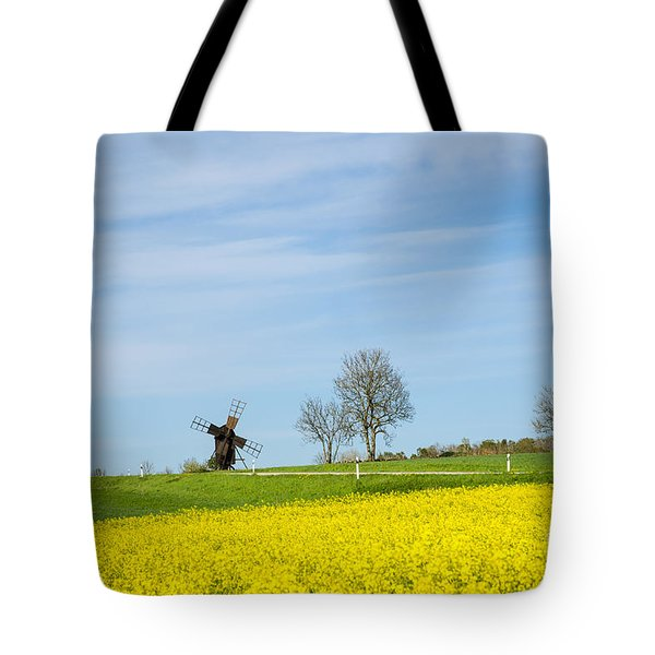 Tote Bag featuring the photograph Old Windmill At A Blossom Rapeseed Field by Kennerth and Birgitta Kullman