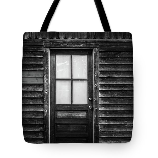 Old Wood Door And Light Black And White Tote Bag by Terry DeLuco