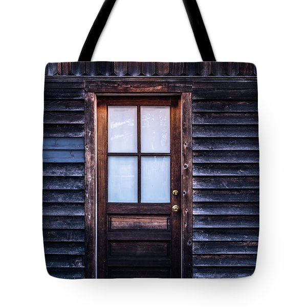 Old Wood Door And Light Tote Bag by Terry DeLuco