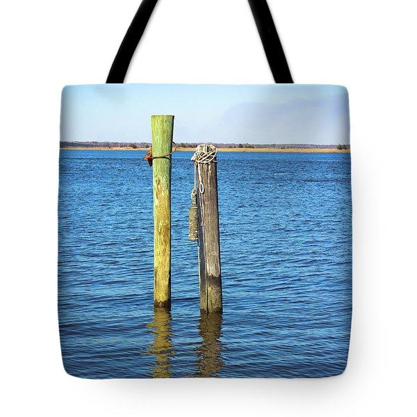Tote Bag featuring the photograph Old Wood Pilings In Blue Water by Colleen Kammerer