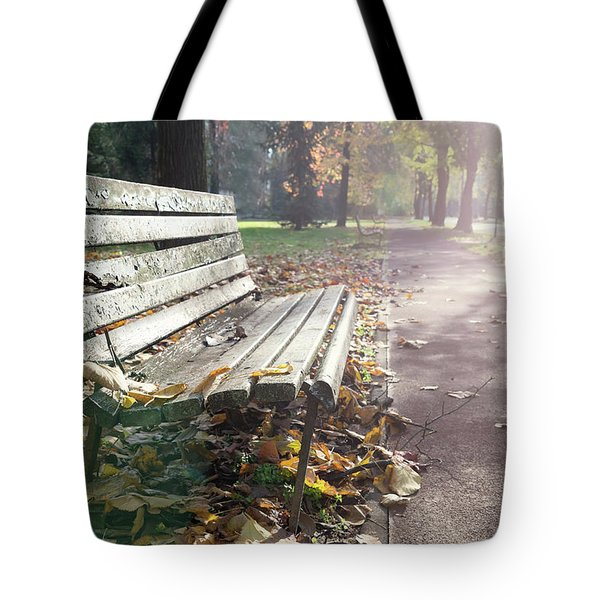 Rustic Wooden Bench During Late Autumn Season On Bright Day Tote Bag