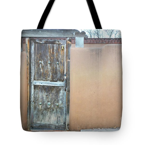 Tote Bag featuring the photograph Old Wooden Door Adobe by Andrea Hazel Ihlefeld