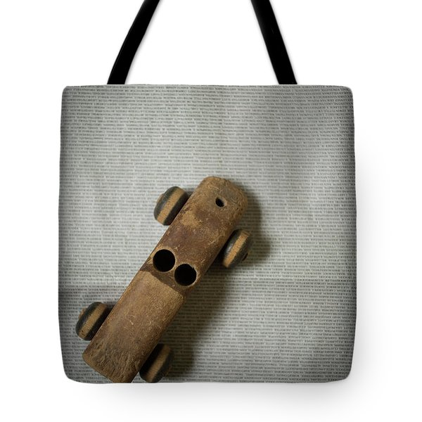 Tote Bag featuring the photograph Old Wooden Toy Car Still Life by Edward Fielding