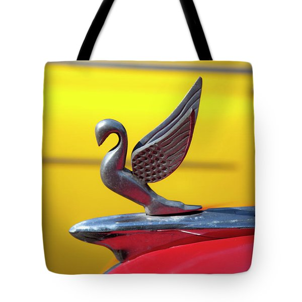 Tote Bag featuring the photograph Oldsmobile Packard Hood Ornament Havana Cuba by Charles Harden