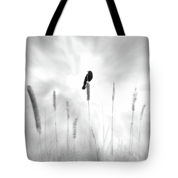 Tote Bag featuring the photograph Omen by John Poon