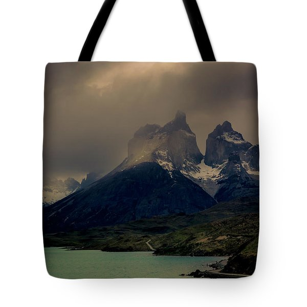 Tote Bag featuring the photograph Ominous Peaks by Andrew Matwijec