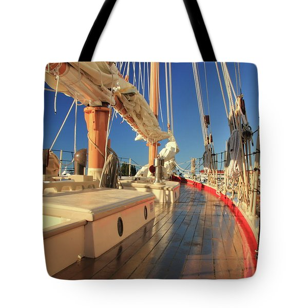 Tote Bag featuring the photograph On Deck Of The Schooner Eastwind by Roupen  Baker