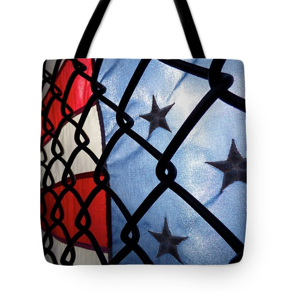 Tote Bag featuring the photograph On The Fence by Robert Geary