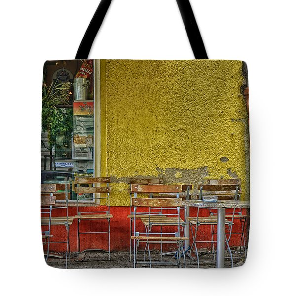Tote Bag featuring the photograph On The Sidewalks Of Berlin by Uri Baruch