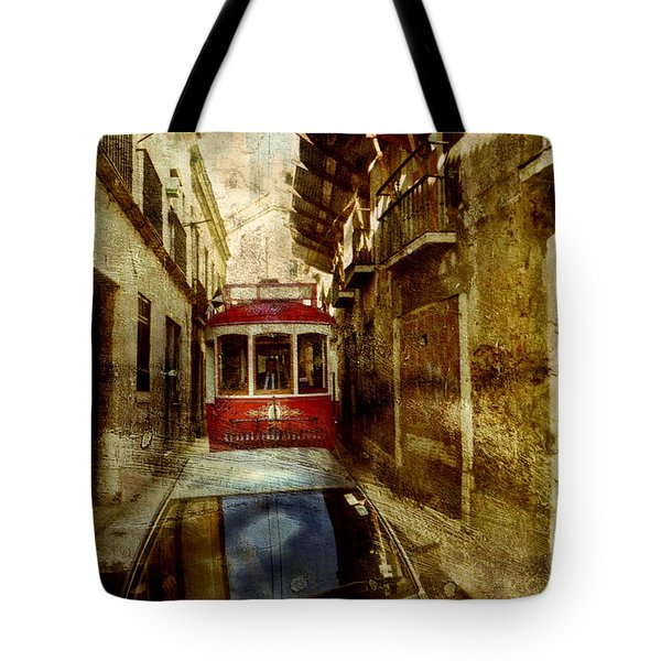 Tote Bag featuring the photograph On The Streets Of Lisbon by Dariusz Gudowicz
