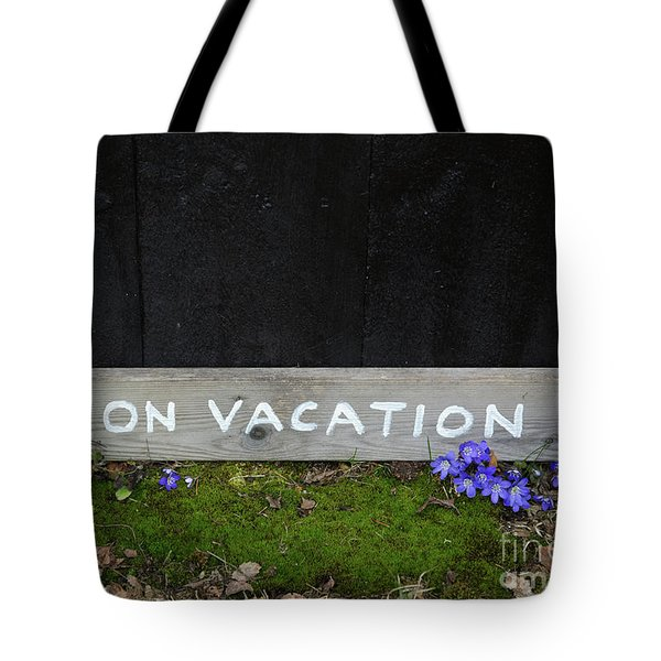 Tote Bag featuring the photograph On Vacation Sign By Blue Flowers by Kennerth and Birgitta Kullman