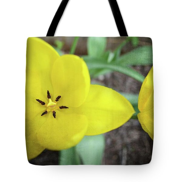 Tote Bag featuring the photograph One And A Half Yellow Tulips by Michelle Calkins
