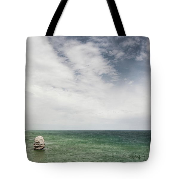 Tote Bag featuring the photograph One Apostle by Joseph Westrupp