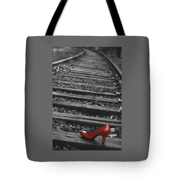 Tote Bag featuring the photograph One Red Shoe by Patrice Zinck