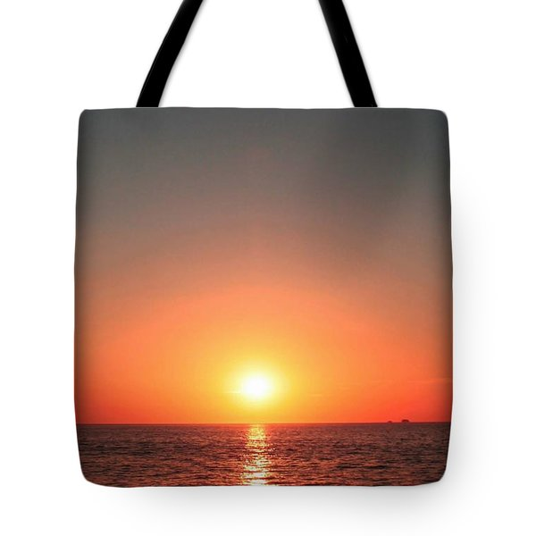 Tote Bag featuring the photograph Orange Arched Sunset On Waves by Ellen Barron O'Reilly