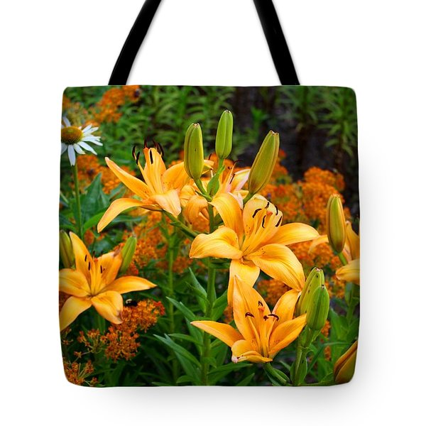 Tote Bag featuring the photograph Orange Asiatic Lilies And Butterfly Weed by Kathryn Meyer