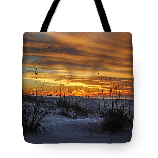 Orange Clouded Sunrise Over The Pier Tote Bag by Michael Thomas