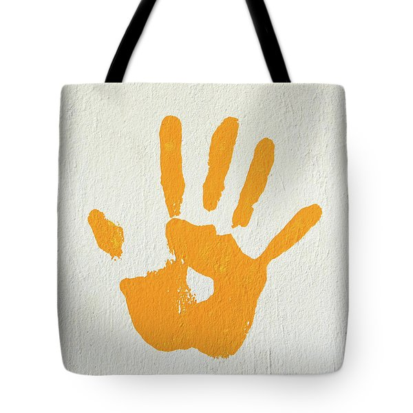 Orange Handprint On A Wall Tote Bag