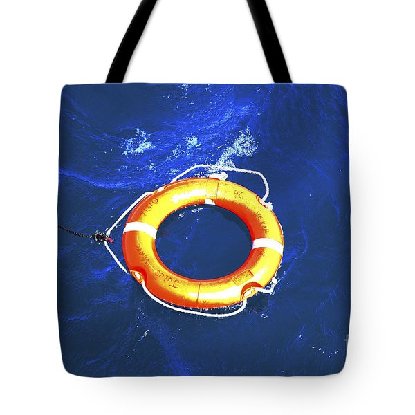 Orange Life Buoy In Blue Water Tote Bag by Jacki Costi