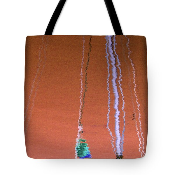 Tote Bag featuring the photograph Orange Reflection On Water by Emanuel Tanjala