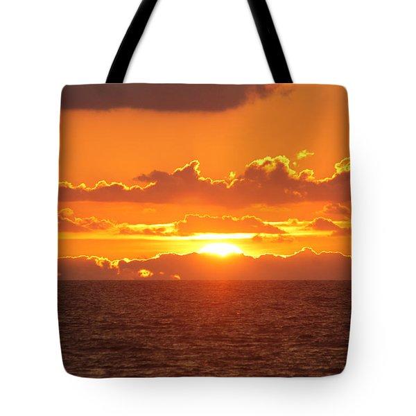 Orange Skies At Dawn Tote Bag by Robert Banach