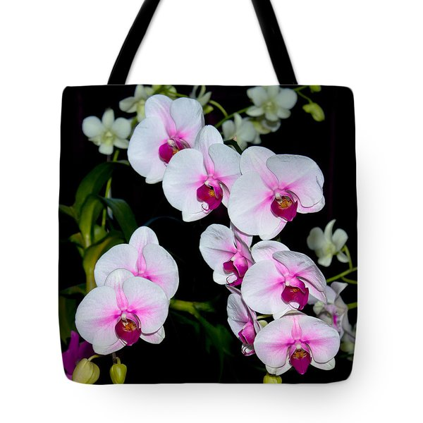 Tote Bag featuring the photograph Orchids On Black by Michele A Loftus