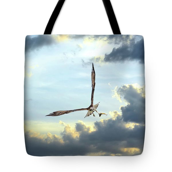 Osprey Flying In Clouds At Sunset With Fish In Talons Tote Bag