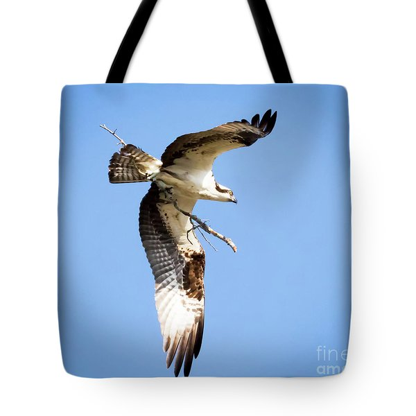 Tote Bag featuring the photograph Osprey In Flight by Ricky L Jones