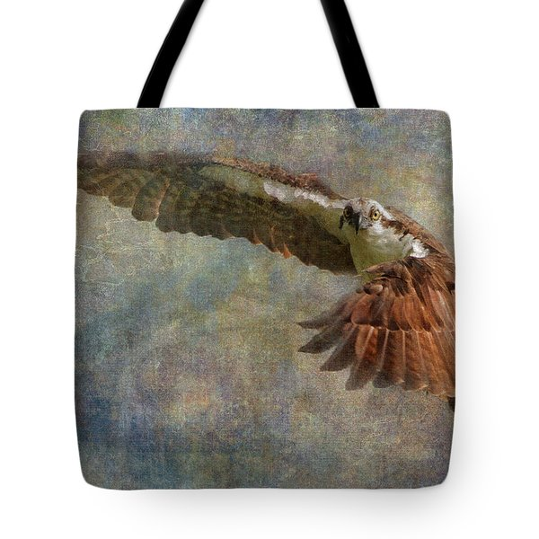 Tote Bag featuring the photograph Osprey Spring by Angie Vogel
