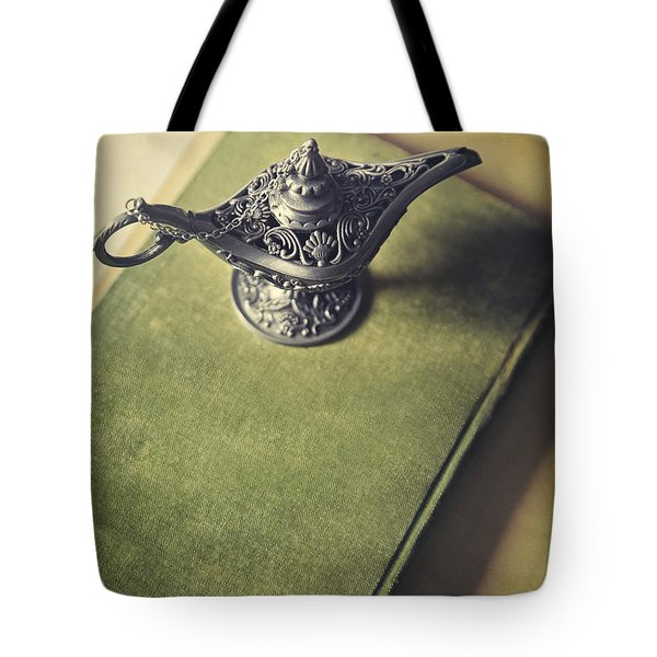 Over Head View Of Genie Lamp On A Book Tote Bag by Sandra Cunningham