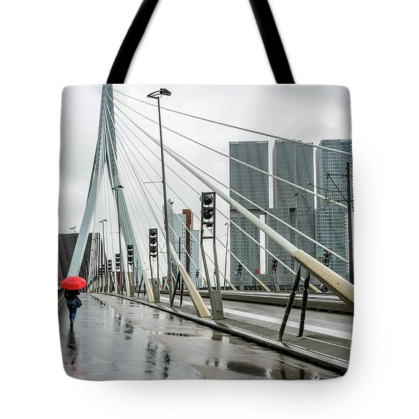 Tote Bag featuring the photograph Over The Erasmus Bridge In Rotterdam With Red Umbrella by RicardMN Photography