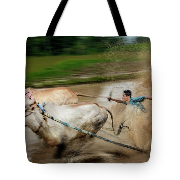 Tote Bag featuring the photograph Pacu Jawi Bull Race Festival by Pradeep Raja Prints
