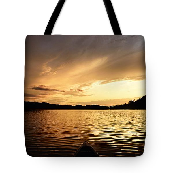 Tote Bag featuring the photograph Paddling At Sunset On Kekekabic Lake by Larry Ricker