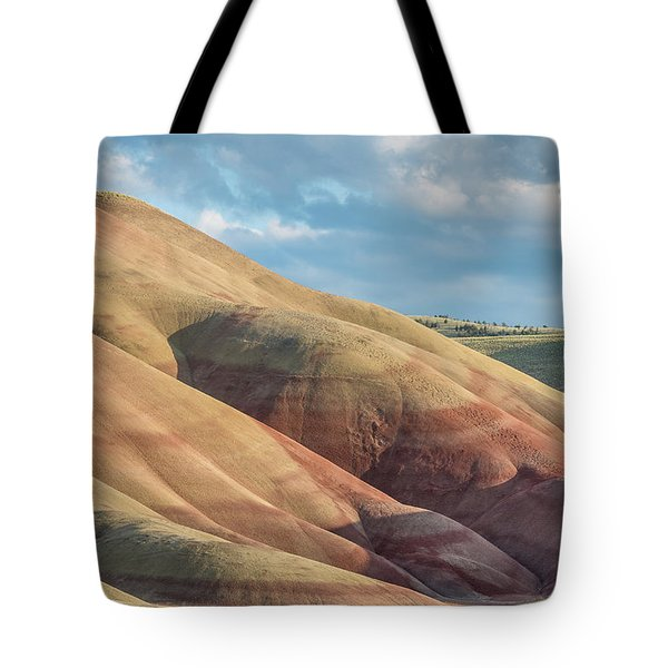 Tote Bag featuring the photograph Painted Hill And Clouds by Greg Nyquist
