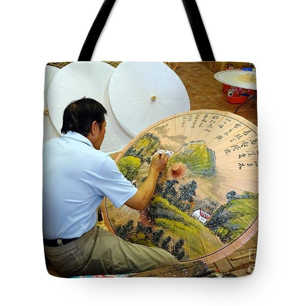 Tote Bag featuring the photograph Painting Chinese Oil-paper Umbrellas by Yali Shi